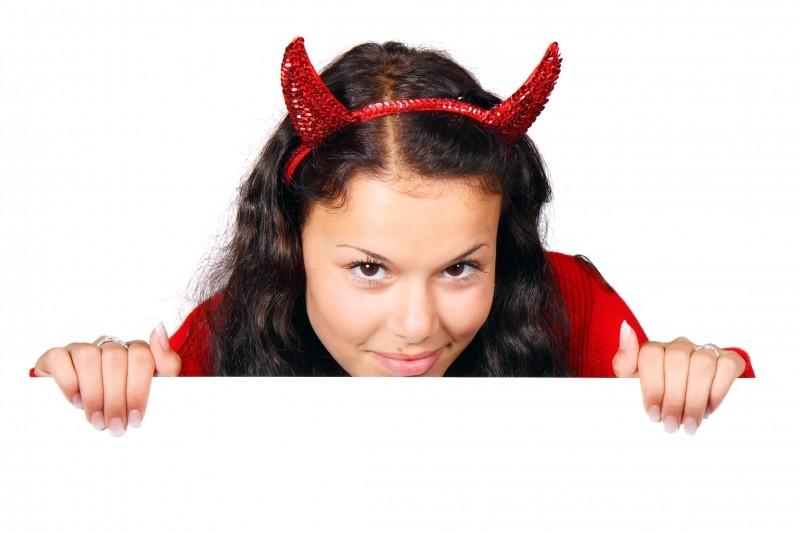 studio-shot-of-cute-young-woman-wearing-devils-costume