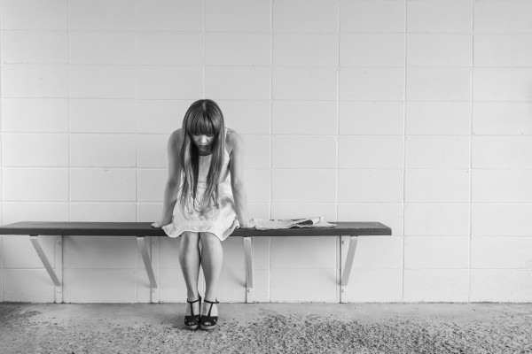 worried-girl-woman-waiting-sitting-thinking-worry